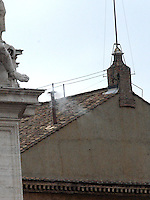 Roma, Città del Vaticano, 19-4-2005: la fumata bianca alle 18 annuncia al mondo e ai numerosi fedeli in attesa in piazza San Pietro che finalmente i cardinali hanno eletto il nuovo Papa.<br /> <br /> <br /> <br /> Rome, Vatican City, 19-4-2005: at 6 pm the white smoke signal annonces at the whole world that the new Pope has been elected by the cardinals reunited in Conclave and he will soon appear at the central window of the façade of Saint Peter's Basilica to bless the faithfuls.<br /> <br /> © Riccardo De Luca