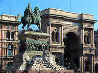 Statue of King Vittorio Emanuele II on horseback in the Piazza Duomo with the Galleria Vittorio Emanuele behind, Milan, Ital
