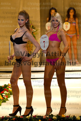 Zsofia Protar (left) and Kitti Ochlslager (right) attends the Miss Hungary 2010 beauty contest held in Budapest, Hungary on November 29, 2010. ATTILA VOLGYI