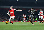 Arsenal's Rob Holding tries to stop a shot from Southampton's Sofiane Boufal during the EFL Cup match at the Emirates Stadium, London. Picture date October 30th, 2016 Pic David Klein/Sportimage