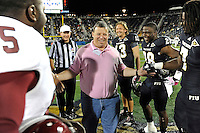 25 October 2011:  FIU's honorary captain, Glenn Parker, shakes hands with players prior to the pre-game coin toss.  The FIU Golden Panthers defeated the Troy University Trojans, 23-20 in overtime, at FIU Stadium in Miami, Florida.
