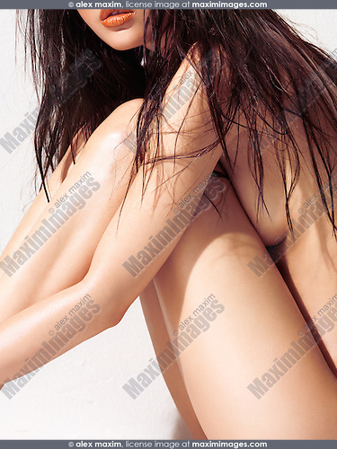 Sexy nude woman with long wet brown hair side view closeup