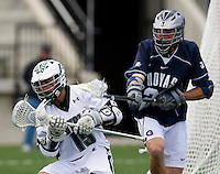 Matt Langan (15) of Loyola tries to go to goal past Patrick Schmitz (26) of Georgetown at the Ridley Athletic Complex in Baltimore, MD.  Loyola defeated Georgetown, 11-6.