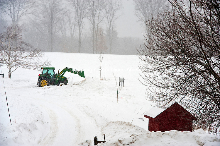 LITCHFIELD,  CT-021415JS02- A worker from White Flower Farms in Litchfield, clears snow from an access road as more snow falls in the region on Saturday. Below freezing temperatures, high gusty winds and even more snow if on tap into next week. <br />  Jim Shannon Republican-American
