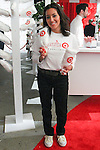 Woman holds cotton candy at the Annie For Target collection celebration and pop-up shop at Stage 37 in New York City on November 4, 2014.