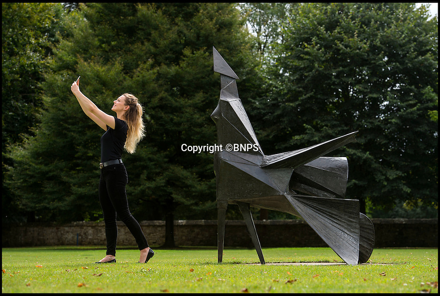 BNPS.co.uk (01202 558833)<br /> Pic: PhilYeomans/BNPS<br /> <br /> Photo-opportunity as a new bronze sculpture is unveiled at Salisbury Cathedral yesterday...<br /> <br /> Artist Lynn Chadwick's 'Walking Woman' sculpture was installed on the west lawn of Salisbury Cathedral yesterday.<br /> <br /> The monumental walking woman is considered one of the great achievements of Chadwicks career, a strong confident figure, with an immense cloak billowing behind as she marches towards the cathedral.<br /> <br /> The cathedral is renowned for its promotion of the art's in and around the 800 year old building that boasts Britains tallest spire and welcomes over 300,00 visitors from all over the world each year.