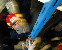 080513-N-7981E-474 ARABIAN GULF (May 13, 2008)- Machinist's Mate Fireman Andrew Dojahn, assigned to Repair Locker Three, helps erect k-type shoring to reinforce a bulkhead that has sustained simulated damage during a General Quarters drill aboard Nimitz-class aircraft carrier USS Abraham Lincoln (CVN 72). Lincoln is deployed to the U.S. Navy 5th Fleet area of responsibility to support Maritime Security Operations (MSO).  MSO help develop security in the maritime environment, which promotes stability and global prosperity.  These operations complement the counterterrorism and security efforts of regional nations and seek to disrupt violent extremists' use of the maritime environment as a venue for attack or to transport personnel, weapons or other material.  U.S. Navy Photo by Mass Communication Specialist 2nd Class James R. Evans (RELEASED)