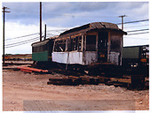 Two dilapidated coaches awaiting restoration at Hawaiian Railroad Society yards.<br /> Oahu Ry. &amp; Land Co.  Honolulu, Hi