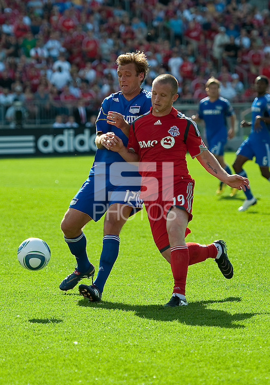 05 June 2010: Kansas City Wizards defender Jimmy Conrad #12 battles with Toronto FC forward Chad Barrett #19 during a game between the Kansas City Wizards and Toronto FC at BMO Field in Toronto..The game ended in a 0-0 draw.