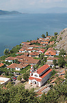 Lin-Pogradec-Albania - August 02, 2004---Partial view of the peninsula and the village of Lin, with its church, and the Lake Ohrid (wih Macedonian mountains and shore at the horizon); region/village of project implementation by GTZ-Wiram-Albania (German Technical Cooperation, Deutsche Gesellschaft fuer Technische Zusammenarbeit (GTZ) GmbH); landscape-religion---Photo: © HorstWagner.eu