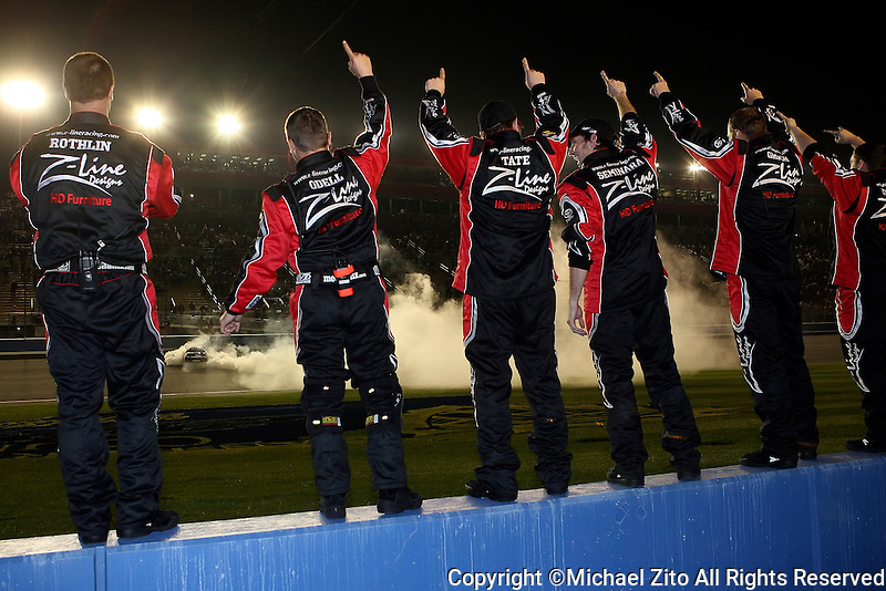 February 21, 2009 Fontana, CA: Kyle Busch's Pit Crew cheers him on after winning the Stater Brothers 300. This was Busch's 2nd win of the Day, winning the San Bernardino County 200 earlier in the day