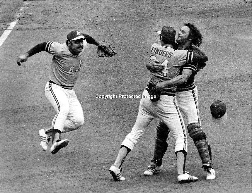 Sal Bando about to jump on Rollie Fingers and Dave Duncan after the final out to beat the Red's in the 72 World Series (photo copyright 1972 Ron Riesterer)