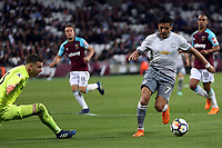 Alexis Sanchez of Manchester United goes around Adrian of West Ham United during West Ham United vs Manchester United, Premier League Football at The London Stadium on 10th May 2018