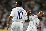 Real Madrid's Robinho and Roberto Carlos shake hands during UEFA Champions League match between Real Madrid and Dynamo Kyiv at Santiago Bernabeu stadium in Madrid, Tuesday September 27 2006. (ALTERPHOTOS/Alvaro Hernandez).