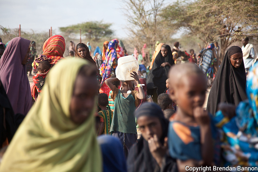 Refugees who have just arrived at Dadaab refugee camp wait at a reception area in the first days after arriving. The emergency situation has created a backlog for the registration process, which is key for refugees to get a regular, predictablea nd adequate supply of food.