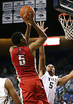 UNLV's Christian Wood (5) shoots over Nevada defender Kaileb Rodriguez (5) during a college basketball game in Reno, Nev., on Tuesday, Jan. 27, 2015. (Las Vegas Review-Journal/Cathleen Allison)