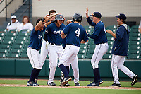 Lakeland Flying Tigers left fielder Elvis Rubio (20) is mobbed by his teammates after drawing a walk to force in the game winning run during the first game of a doubleheader against the St. Lucie Mets on June 10, 2017 at Joker Marchant Stadium in Lakeland, Florida.  Lakeland defeated St. Lucie 6-5 in fourteen innings.  (Mike Janes/Four Seam Images)