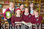 LET'S READ: Pupils form Glenderry national school, Ballyheigue at the official opening of the school library on Friday morning were delighted to meet real life author Gabriel Fitzmaurice. From front l-r were: Aoife Carlin, Ciara Reidy and Megan Lynch. Back l-r were: Ciarda Supple, Gabriel Fitzmaurice, Meabh Keane and Amy Lucid.