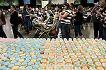 November 15, 2008. Fayetteville, NC..One thousand Army wives and active duty soldiers pregnant with what the locals call ?surge babies? were celebrated at the biggest military baby shower ever. These babies were conceived when.troops from the 82nd Airborne Division, deployed to Iraq for the surge of forces in January 2007, began returning home to Fort Bragg in November.. The cupcakes by the entrance door await the attendees.