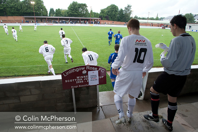 Linlithgow Rose, dressed in their change strip of white, taking to the field at their Prestonfield ground for Dechmont Forklift League Cup group match against local rivals Pumpherston Juniors, which the home side won 4-0. Junior football was divided into East, West and North sections and played throughout Scotland. It had its own governing body, the SJFA and regional pyramid structure and national cup competition.