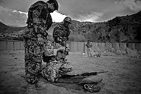 A Latvian military mentor helps an Afghan soldier who's weapon jammed while practicing at the shooting range  at Forward Operating Base Bostick in Northern Kunar Province, Afghanistan on Saturday March 27 2010...Afghan soldiers are from 1st Coi ( Company ), 1st Kandak ( battalion ) 2nd Brigade.