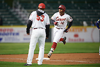 Altoona Curve designated hitter Edwin Espinal (14) runs the bases after hitting a home run with Greg Picard (53) looking on during a game against the New Hampshire Fisher Cats on May 11, 2017 at Peoples Natural Gas Field in Altoona, Pennsylvania.  Altoona defeated New Hampshire 4-3.  (Mike Janes/Four Seam Images)
