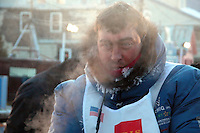 Steam rises from John Baker as he arrives in the daylight in Nome. Photo by Jon Little.