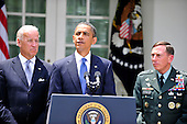 United States President Barack Obama, center, announces he is replacing General Stanley McChrystal, United States Army, Commander, International Security Assistance Force (ISAF) with General David H. Petraeus, Chief of the United States Central Command (CENTCOM), right, in Washington, D.C. on Wednesday, June 23, 2010.  Vice President Joseph Biden looks on from left..Credit: Ron Sachs / Pool via CNP