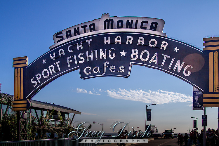 The Santa Monica Pier is  located at the foot of Colorado Avenue in Santa Monica, California and is a prominent, 100-year-old landmark. The pier contains Pacific Park, a family amusement park with a large Ferris wheel.<br /> <br /> the current Santa Monica Pier is actually two adjoining piers that long had separate owners. The long, narrow Municipal Pier opened September 9, 1909, primarily to carry sewer pipes beyond the breakers, and had no amenities. The short, wide adjoining Pleasure Pier to the south, a.k.a. Newcomb Pier, was built in 1916 by Charles I. D. Looff and his son Arthur, amusement park pioneers.