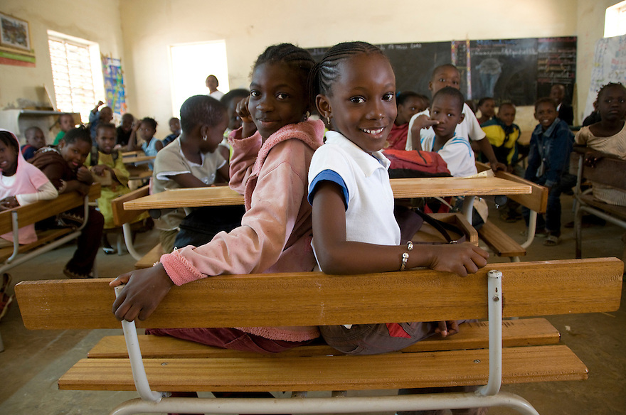 Dakar, Senegal/May 17, 2010 - Two students at the HLM 4C school in Dakar, Senegal await the arrival of UNICEF Executive Director Anthony Lake. Mr. Lake was in Senegal to participate in the E4 confernece of the United Nations Girls Education Initiative in Dakar.