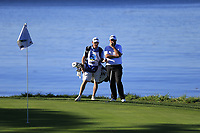 Shane Lowry (IRL) and caddy Dermot Byrne on the 5th green at Pebble Beach course during Friday's Round 2 of the 2018 AT&amp;T Pebble Beach Pro-Am, held over 3 courses Pebble Beach, Spyglass Hill and Monterey, California, USA. 9th February 2018.<br /> Picture: Eoin Clarke | Golffile<br /> <br /> <br /> All photos usage must carry mandatory copyright credit (&copy; Golffile | Eoin Clarke)