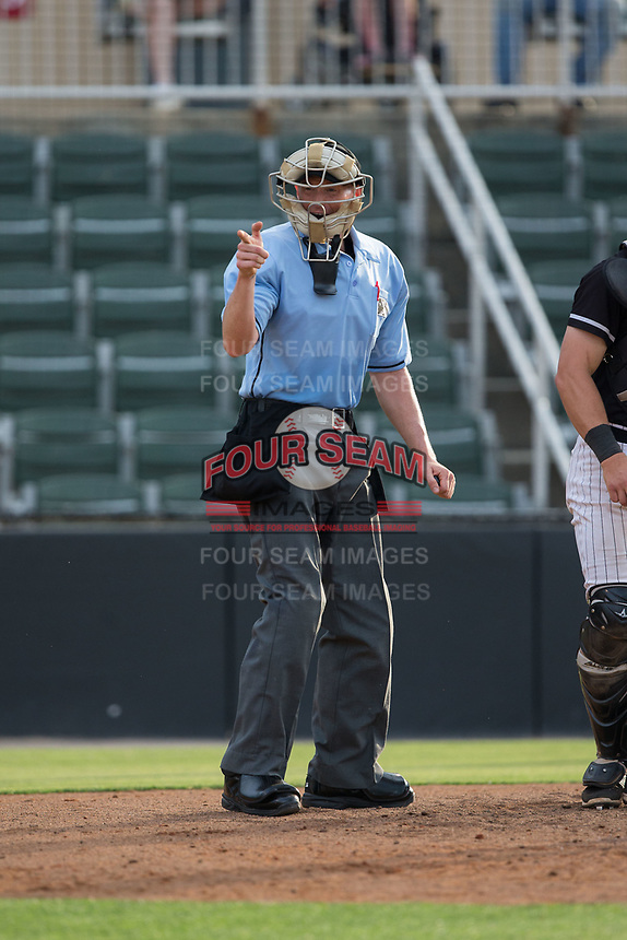 Home plate umpire Mike Snover makes a strike call during the South Atlantic League game between the Hickory Crawdads and the Kannapolis Intimidators in game one of a double-header at Kannapolis Intimidators Stadium on May 19, 2017 in Kannapolis, North Carolina.  The Crawdads defeated the Intimidators 5-4.  (Brian Westerholt/Four Seam Images)