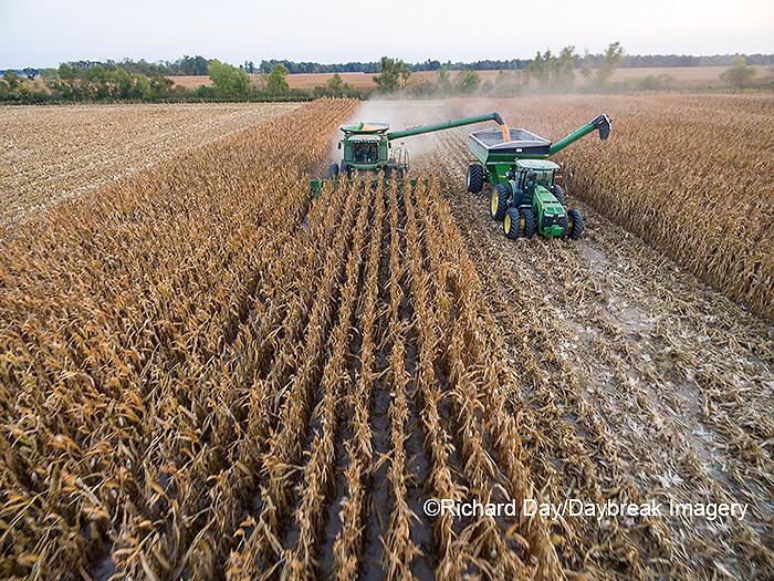 63801-08218 Corn Harvest, John Deere combine unloading corn into grain cart while harvesting - aerial Marion Co. IL