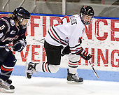 Casey Knajdek (UConn - 5), Kelly Wallace (NU - 5) - The University of Connecticut Huskies defeated the Northeastern University Huskies 4-1 in Hockey East quarterfinal play on Saturday, February 27, 2010, at Matthews Arena in Boston, Massachusetts.