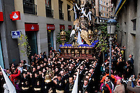 The large throne, with the Paso scene featuring Jesus Christ and Virgin Mary on the top, is carried in a narrow street during the Holy Week fiesta in Malaga, Spain, 7 April 2007.