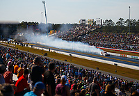 Mar 17, 2018; Gainesville, FL, USA; NHRA funny car driver Cory Lee does a half track burnout during qualifying for the Gatornationals at Gainesville Raceway. Mandatory Credit: Mark J. Rebilas-USA TODAY Sports