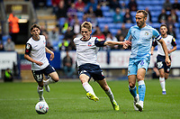 Bolton Wanderers' Ronan Darcy breaks away from Coventry City's Liam Kelly (right) <br /> <br /> Photographer Andrew Kearns/CameraSport<br /> <br /> The EFL Sky Bet Championship - Bolton Wanderers v Coventry City - Saturday 10th August 2019 - University of Bolton Stadium - Bolton<br /> <br /> World Copyright © 2019 CameraSport. All rights reserved. 43 Linden Ave. Countesthorpe. Leicester. England. LE8 5PG - Tel: +44 (0) 116 277 4147 - admin@camerasport.com - www.camerasport.com