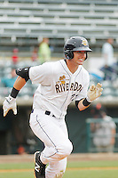 Charleston RiverDogs outfielder Austin Aune (22) at bat during a game against the Augusta GreenJackets at Joseph P.Riley Jr. Ballpark on April 15, 2015 in Charleston, South Carolina. Charleston defeated Augusta 8-0. (Robert Gurganus/Four Seam Images)