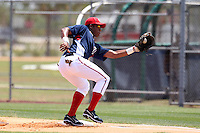 GCL Nationals Arialdi Peguero #15 takes a pickoff throw during a game against the GCL Mets at the Washington Nationals Minor League Complex on June 20, 2011 in Melbourne, Florida.  The Nationals defeated the Mets 5-3.  (Mike Janes/Four Seam Images)