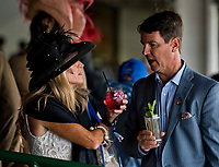LOUISVILLE, KY - MAY 05: A woman drinks her Oaks Lily and a man drinks his Mint Julep on Kentucky Oaks Day at Churchill Downs on May 5, 2017 in Louisville, Kentucky. (Photo by Scott Serio/Eclipse Sportswire/Getty Images)