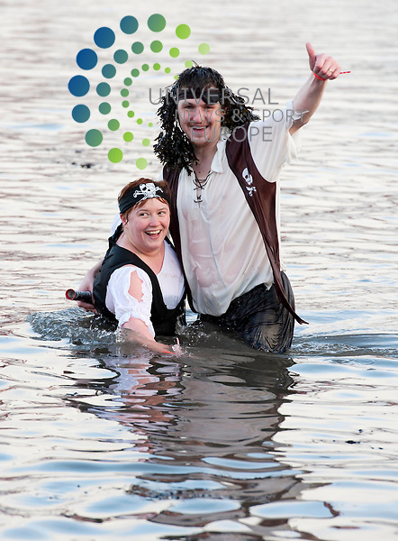 Celebrate the arrival of 2012 by taking part in the incredible Loony Dook, the annual splash in the River Forth in the shadow of the world-famous Forth Rail Bridge. Join in the Grand Parade and cheer-on the brave Loony Dookers as they make their way along Queensferry's High Street to dook in the freezing Forth. Picture: Pavol Mraz/Universal News And Sport (Scotland). 1/January 2012.