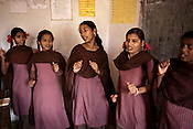 Students sing and dance to Aflatoon songs as they attend their classes in a government run school in Caregaon, Thane, Maharashtra. These schools run a specially designed concept of 'aflatoon' as part of the curriculam whereby students are made aware of their child as described in the convention of rights of child. These students are made aware of right to survival, right to protection, right to development and right to participation.