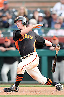 Gary Brown #86 of the San Francisco Giants bats against the Arizona Diamondbacks in the first spring training game of the season at Scottsdale Stadium on February 25, 2011  in Scottsdale, Arizona. .Photo by:  Bill Mitchell/Four Seam Images.