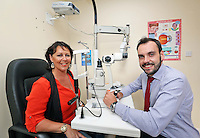 12/08/14  Optical Express competition winner, Adrienne Moore has her eyes examined by Rory Dowds, Senior Refractive Optometrist at Optical Express..<br /> Balbriggan mum, Adrienne was so delighted with the results of her lens replacement surgery at Optical Express, that her mum, Kathleen also decided to undergo the procedure. They are both extremely happy with the results, especially Kathleen who had the onset of cataracts and was suffering from increasingly cloudy vision... Picture Colin Keegan, Collins Dublin.