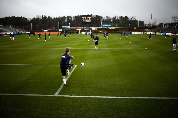 """March 14, 2009. Cary, NC.. The Carolina Railhawks went home in foul weather with a  1-0 victory over the New England Revolution of the MLS, in the inaugural """"Community Shield"""" match and their first professional outing under new coach, Martin Rennie. . Players warm up before the game."""