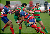 Though being hit in a big tackle by S. Te Tamaki O. Latatasi gets his pass away.Counties Manukau Premier Club Rugby, Ardmore Marist vs Waiuku played at Bruce Pulman Park, Papakura on the 29th of April 2006. Ardmore Marist won 10 - 9.
