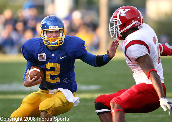 BROOKINGS SD -- SEPTEMBER 6 -- South Dakota State quarterback Ryan Berry #2 tries to get past Youngstown State defender Andre Elliott #2 in the second quarter of their game Saturday evening in Brookings, S.D. (Photo by Dick Carlson/Inertia)