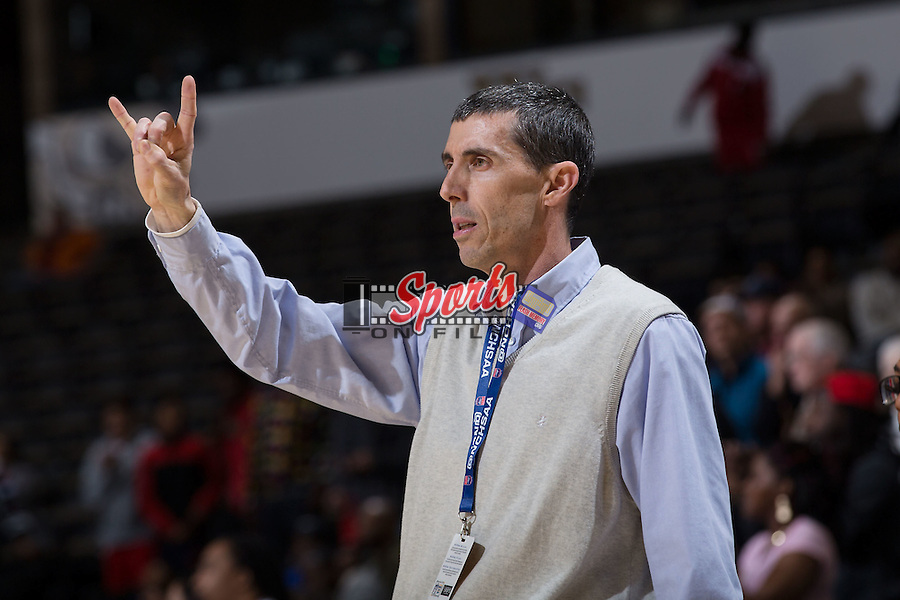 Hickory Red Tornadoes head coach Andy Poplin calls out a play in overtime against the Jay M. Robinson Bulldogs in the NCHSAA 3A Regional Championship at the LJVM Coliseum on March 5, 2016 in Winston-Salem, North Carolina.  The Bulldogs defeated the Red Tornadoes 67-66 in overtime. (Brian Westerholt/Sports On Film)