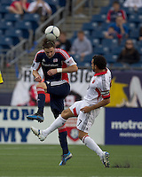 New England Revolution midfielder Stephen McCarthy (26) heads the ball as DC United midfielder Dwayne De Rosario (7) closes. In a Major League Soccer (MLS) match, DC United defeated the New England Revolution, 2-1, at Gillette Stadium on April 14, 2012.