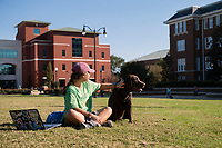 Kinesiology major Callie Wells on the Drill Field with her dog Theo.<br />  (photo by Megan Bean / &copy; Mississippi State University)